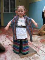 Little Girl Showing Off Her New Rebozo and Matching Skirt