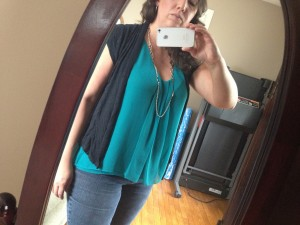Closeup of the breezy teal turquoise tank and short sleeved jacket