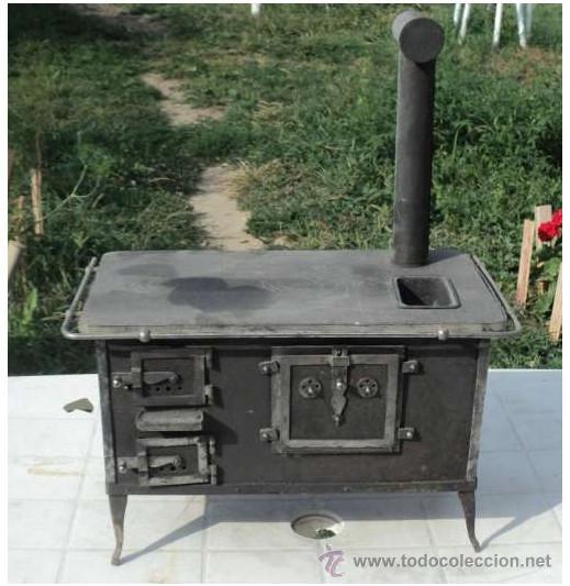 Preciosa y antigua cocina econmica de juguete  Vendido