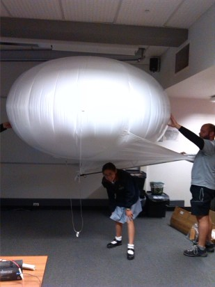 Under the balloon!
