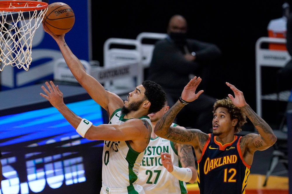 Boston Celtics hold off late Golden State Warriors surge, escape with  111-107 victory to start road trip - masslive.com