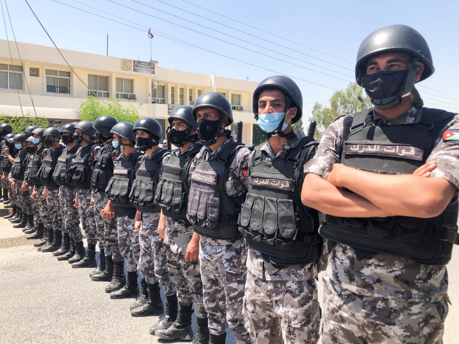 Members of the Jordanian Gendarmerie stand guard during a protest to express solidarity with the Palestinian people, in Karameh, Jordan valley, Jordan May 14, 2021. REUTERS/Jehad Shelbak