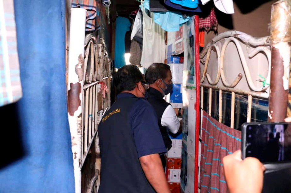 Malaysia's Minister of Human Resources M. Saravanan inspects a workers' dormitory, which glove-maker Brightway Holdings confirms is one of its facilities, in Selangor state, Malaysia December 21, 2020, in this image obtained via social media. Picture taken December 21, 2020. Malaysia Ministry of Human Resources via REUTERS
