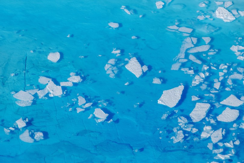 Chunks of ice float inside of meltwater pools on top of the Helheim glacier near Tasiilaq, Greenland, June 19, 2018.  REUTERS/Lucas Jackson/File Photo