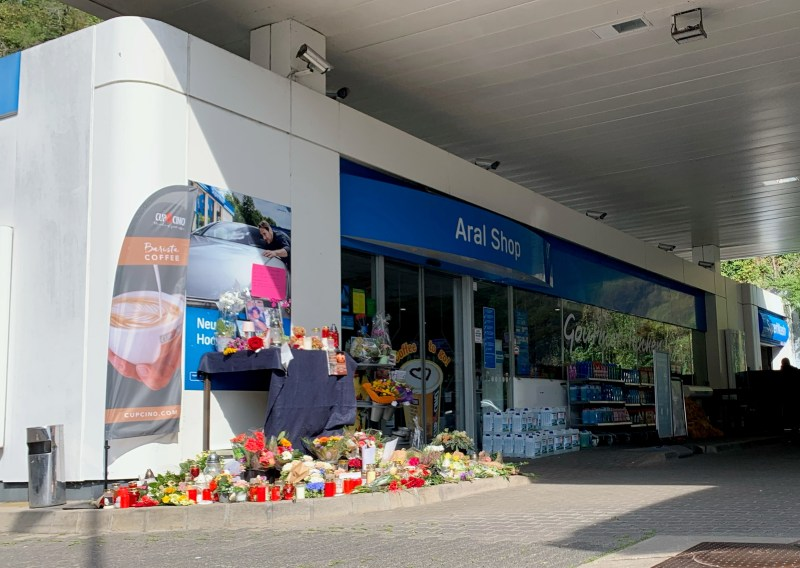 Flowers are placed in front of a gas station in Idar-Oberstein, Germany, September 21, 2021, after a 20-year-old gas station attendant who asked a customer to wear a face mask was shot dead last Saturday, September 18, 2021. REUTERS/Annkathrin Weiss