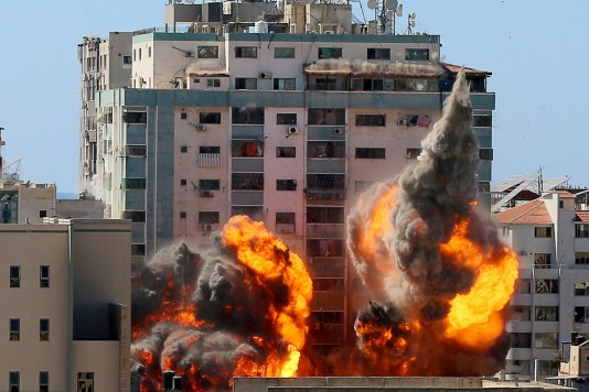 An explosion is seen near a tower housing AP, Al Jazeera offices during Israeli missile strikes in Gaza city, May 15. REUTERS/Ashraf Abu Amrah/File Photo