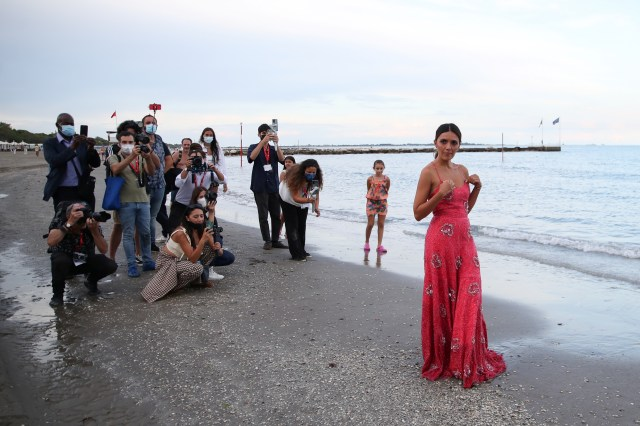 Actress Serena Rossi, who will host the opening ceremony of the 78th Venice International Film Festival, poses during a photocall on the beach, in Venice, Italy, August 31, 2021. REUTERS / Yara Nardi