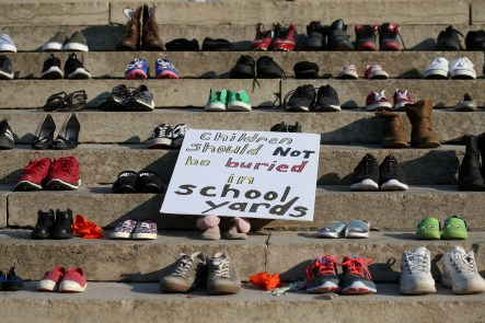 Shoes sit on the steps of the provincial legislature, placed there following the discovery of the remains of hundreds of children at former indigenous residential schools, on Canada Day in Winnipeg, Manitoba, Canada July 1, 2021. REUTERS/Shannon VanRaes/File Photo