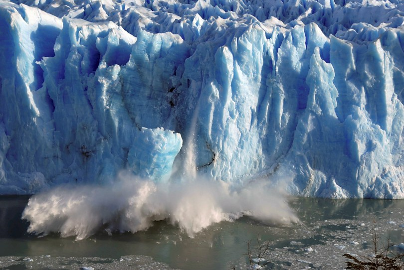 Splinters of ice peel off from one of the sides of the Perito Moreno glacier near the city of El Calafate in the Patagonian province of Santa Cruz, southern Argentina, July 7, 2008. REUTERS/Andres Forza/File Photo