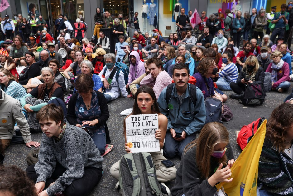 Extinction Rebellion climate demonstrators hold a sitting demonstration at Fenchurch street,  in London, Britain, August 30, 2021. REUTERS/Tom Nicholson