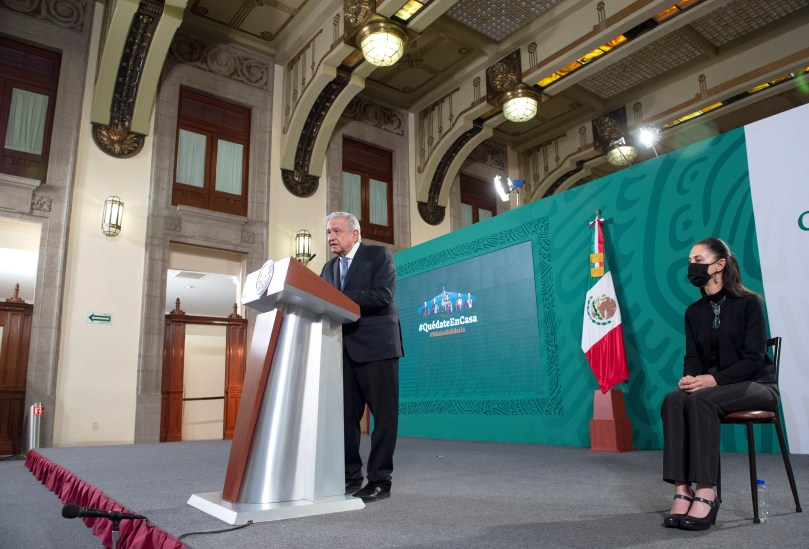 Mexican President Andres Manuel Lopez Obrador speaks as Mexico City Mayor Claudia Sheinbaum looks on during a news conference at the National Palace in Mexico City, Mexico May 4, 2021. Mexico's Presidency/Handout via REUTERS