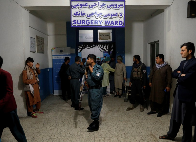 An Afghan policeman stands guard inside a hospital, after a blast in Kabul, Afghanistan May 8, 2021.REUTERS/Stringer