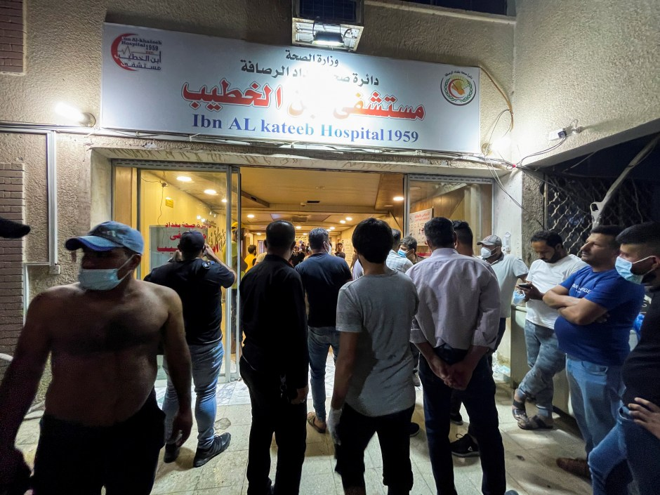 People gather at Ibn Khatib hospital after a fire caused by an oxygen tank explosion in Baghdad, Iraq, April 25, 2021. REUTERS/Thaier Al-Sudani