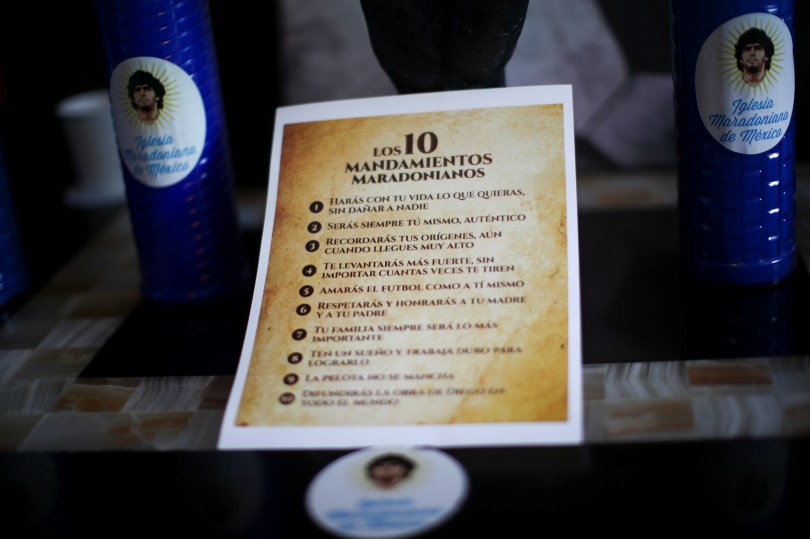 """A sheet with """"commandments"""" is pictured at the first Mexico's church in memory of soccer legend Diego Armando Maradona in San Andres Cholula, in Puebla state, Mexico July 14, 2021. REUTERS/Edgard Garrido"""