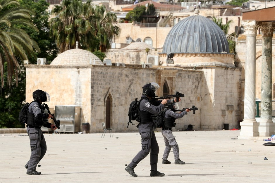 Israeli police clash with Palestinians at the compound that houses Al-Aqsa Mosque, known to Muslims as Noble Sanctuary and to Jews as Temple Mount, in Jerusalem's Old City, May 10, 2021. REUTERS/Ammar Awad