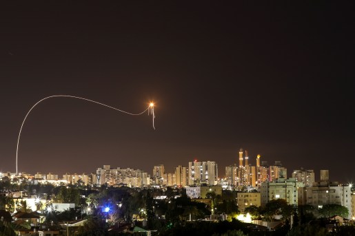 A streak of light is seen as Israel's Iron Dome anti-missile system intercepts rockets launched from the Gaza Strip towards Israel, as seen from Ashkelon, Israel May 16, 2021. REUTERS/Amir Cohen