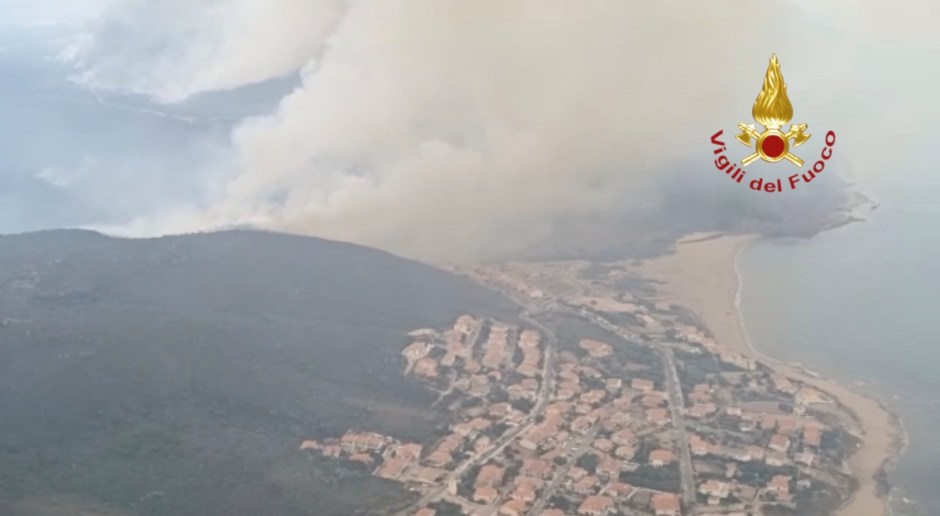 A screen grab taken from a video shows a large wildfire that broke out near Oristano, Sardinia, Italy July 25, 2021. Picture taken July 25, 2021. Vigili del Fuoco/Handout via REUTERS