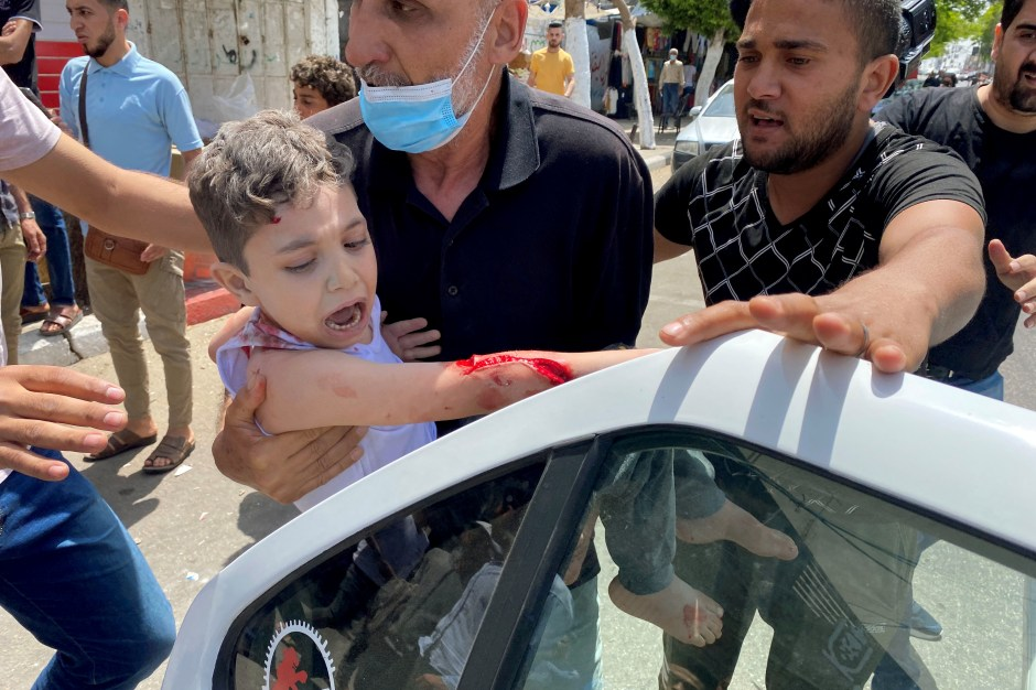 SENSITIVE MATERIAL. THIS IMAGE MAY OFFEND OR DISTURB   A wounded Palestinian boy is rushed to the hospital following an Israeli air strike on a building, amid a flare-up of Israeli-Palestinian violence, in Gaza City May 11, 2021. REUTERS/Mohammed Salem