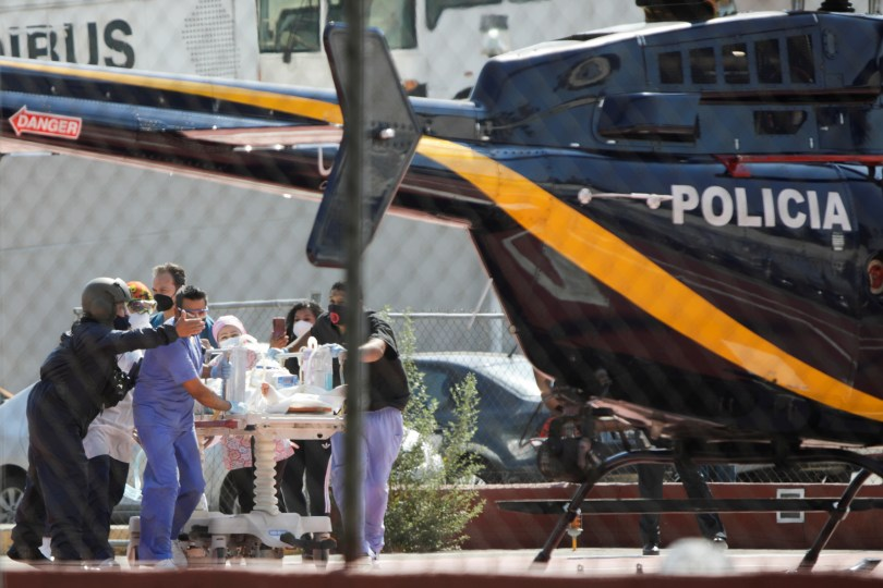 Paramedics transport Brandon Giovani Hernandez, who was injured during the accident where an overpass of the metro partially collapsed with train cars on it at Olivos station, toward a helicopter as he is transferred to another hospital, in Mexico City, Mexico May 4, 2021. REUTERS/Luis Cortes
