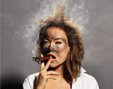 Actor Olivia Wild demonstrating an exploding cigar