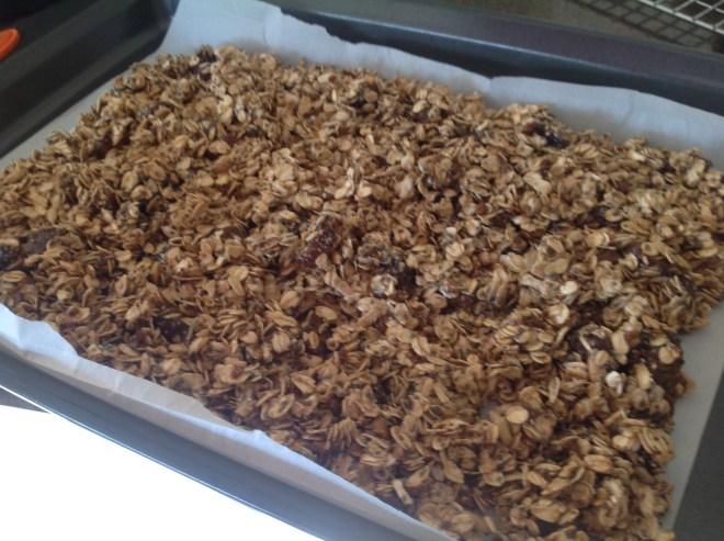 white chocolate granola on baking sheet