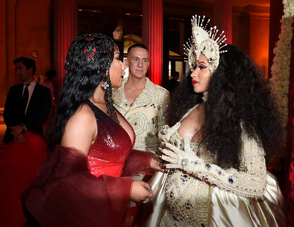 NEW YORK, NY - MAY 07: Nicki Minaj, Designer Jeremy Scott, and Cardi B attend the Heavenly Bodies: Fashion & The Catholic Imagination Costume Institute Gala at The Metropolitan Museum of Art on May 7, 2018 in New York City.  (Photo by Kevin Mazur/MG18/Getty Images for The Met Museum/Vogue)