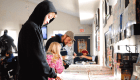 People checking the hockey singles at the CloutsnChara store on National Hockey Card Day 2019