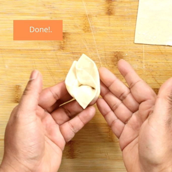 Step 6 - Folding a wonton.