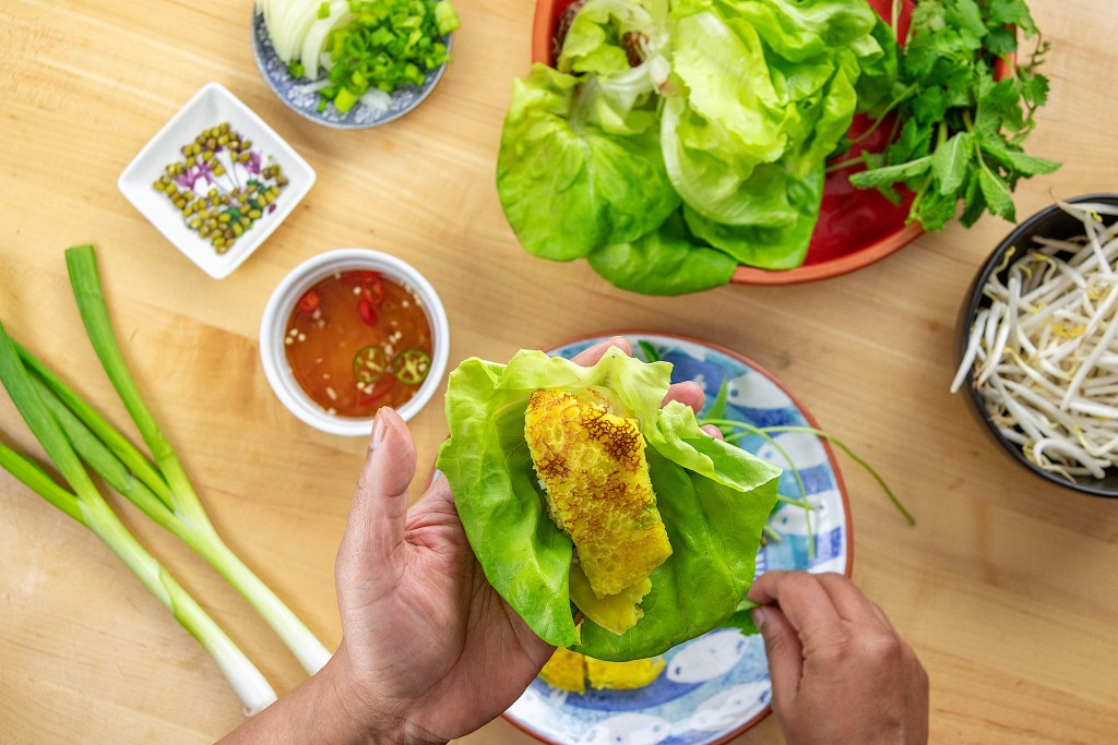 How to eat Banh Xeo Step three