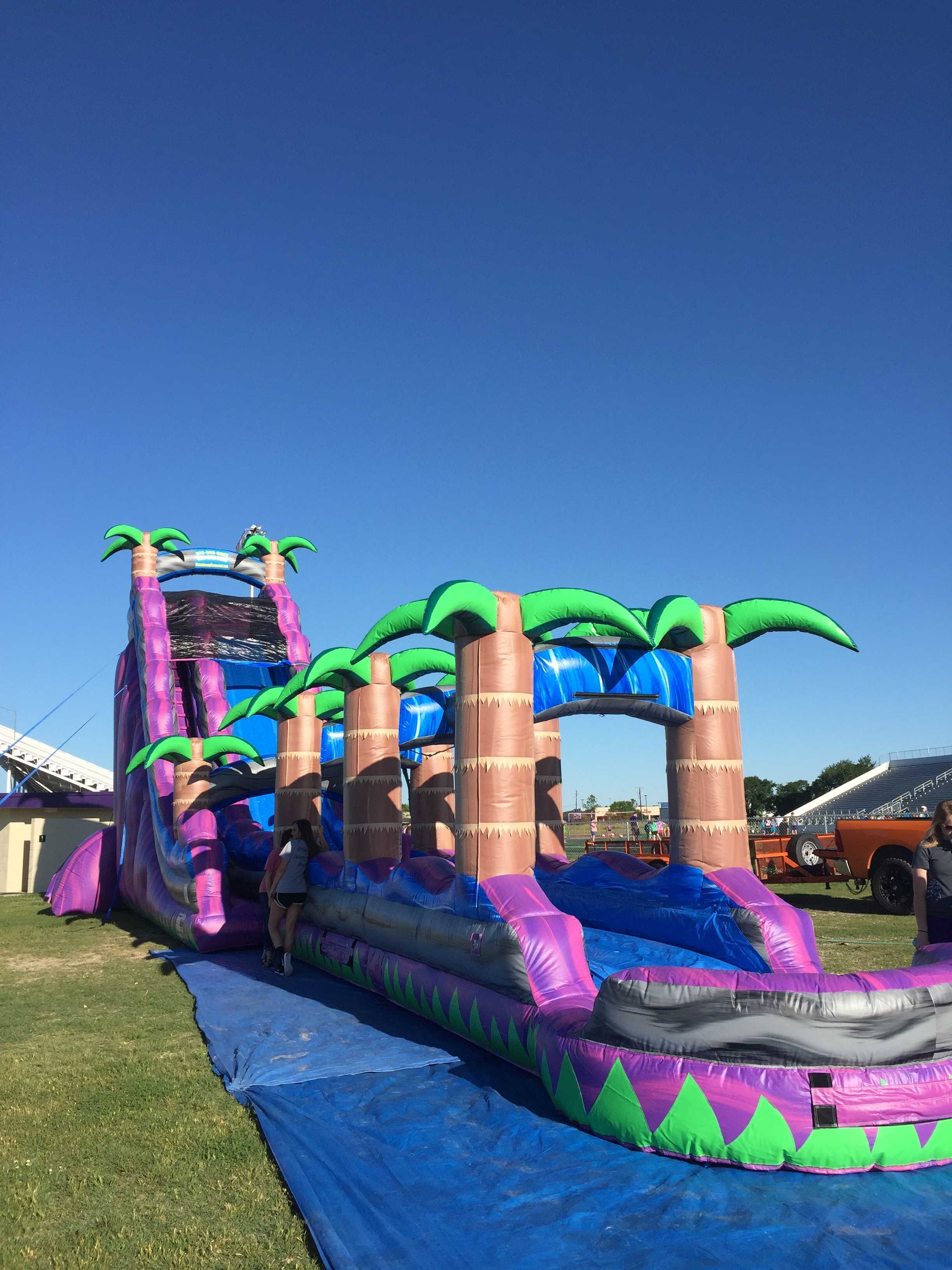 rent table and chairs for party vintage sling chair purple crush water slide | inflatable slides