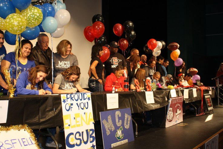 students-signing-their-letters-together.jpg