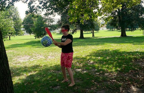 Ruby takesa swing at the Alderaan piñata at JadeCon '08