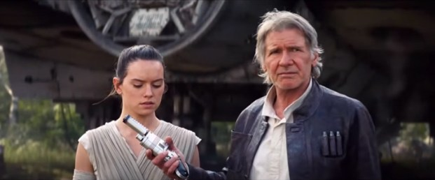 Han hands Rey a blaster. Remember, we saw concept art of her with a Han-style blaster at Celebration.