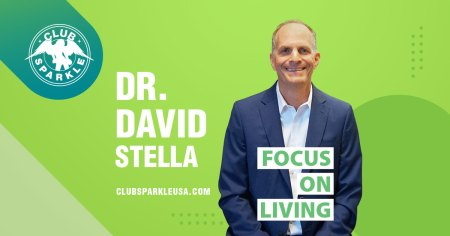 An image of Doctor David Stella wearing a dark blue suit with a white shirt with the words Focus on Living in green superimposed over him.
