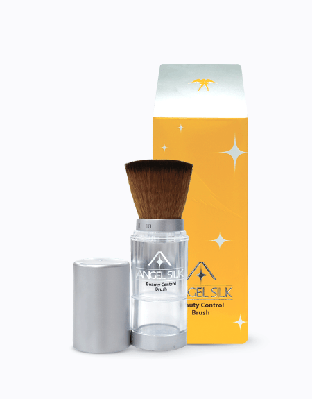 A bottle of angel silk beuaty control brush with the cap off, next to the package that it comes in.