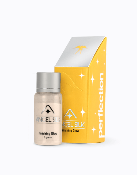 An image of a bottle of Angel Silk finishing glow (5 grams) and the package that it comes in.