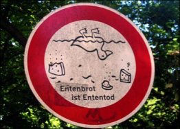 """Lol. For those who are not fluent in German: """"Entenbrot"""" is stale bread you feed to ducks (or generally bread you feed to ducks) and """"Ententod"""" means death of ducks. So basically 'feed ducks = dead ducks'"""