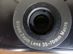 Lens closeup. No automatic cover to get stuck.