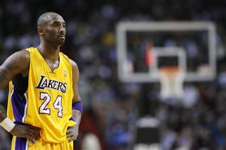 Los Angeles Lakers' Kobe Bryant watches a Miami Heat free throw in their NBA basketball game in Miami, Florida January 19, 2012. REUTERS/Andrew Innerarity