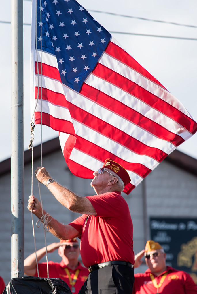 Raising the flag © Nathaniel Knobel