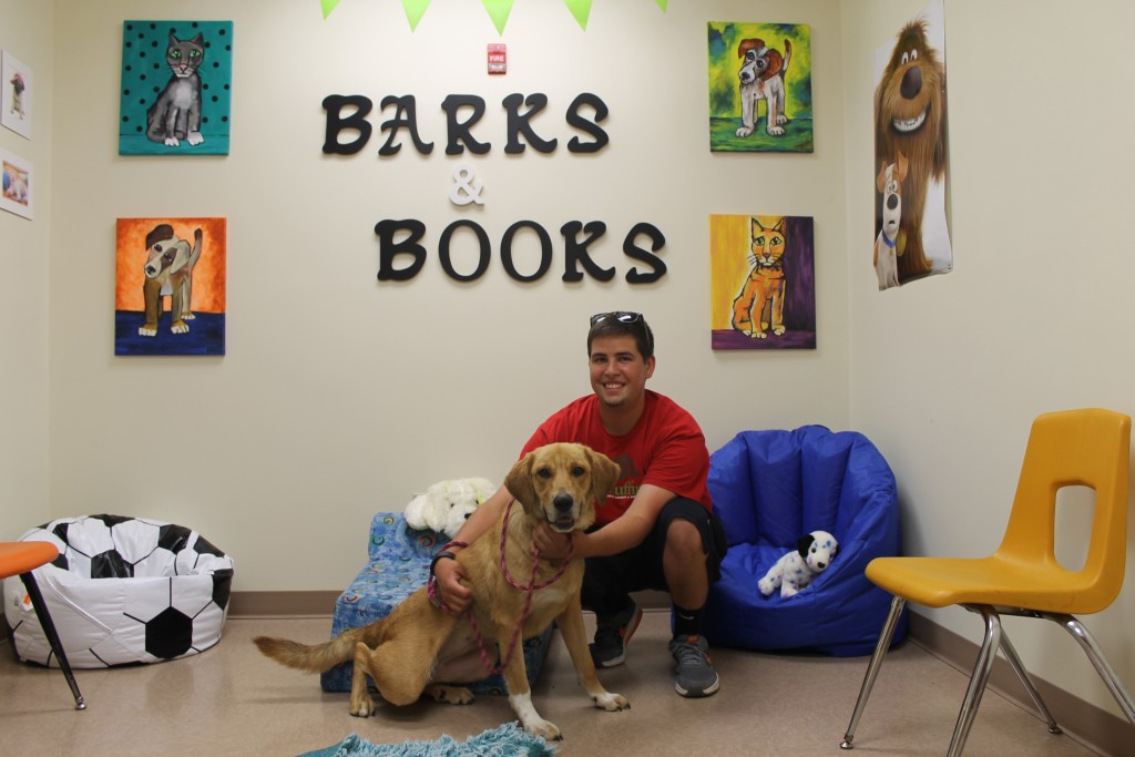 Adam Shaffer pictured with Missy who was participating in Barks & Books for the day.