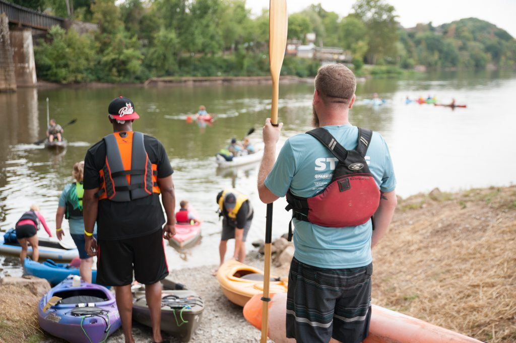 Volunteers helping paddlers launch.