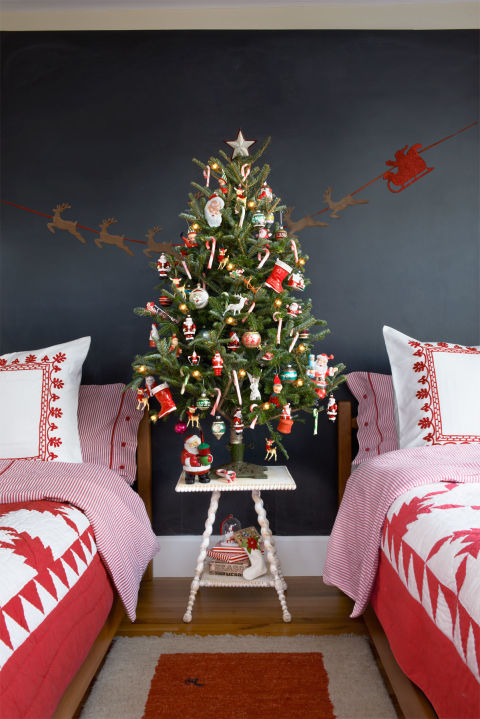 Perfect for a kids' room, this retro tree is as jolly as Kris Kringle himself, thanks to a vintage tree stand and old-school ornaments. (Reindeer Ornaments, $11 each, and Bubble Light Santa, $33; both from avintageholiday.com)