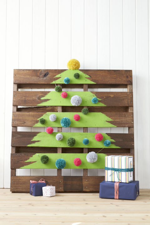 Paint a tree on a shipping crate (you can find 'em for cheap on eBay), and embellish the slats with pom-poms. What you'll need: reclaimed wood quarter pallet ($11, homedepot.com); green chalk furniture paint ($6, amazon.com); large craft pom-poms ($12, amazon.com)