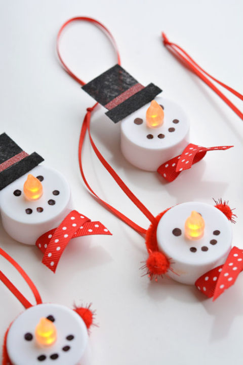 This is a great craft option for a Christmas kids' party.  Get the tutorial at One Little Project.  What you'll need: battery operated tealight candles, ($6, amazon.com); red pipe cleaners ($6, amazon); red pom poms ($7, amazon.com)