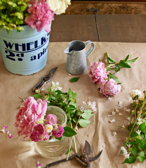 Straight from Prentiss Douthit's garden, peonies, petite 'Sweet Pea' roses, and dainty sprigs of beauty bush (Kolkwitzia amabilis) provide the makings for a casually lush arrangement.