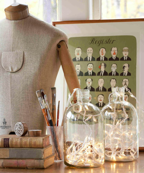 From empty jars to illuminating conversation pieces: Fill a glass jug with Christmas lights to fashion a tricked-out table lamp. —Sirpa Cowell, textile designer