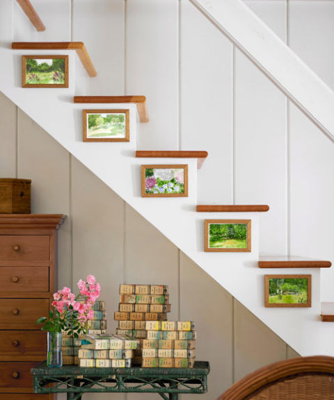 The watercolors are by family friend Bonnie Egan, while the home's previous owner left behind the colorful vintage books. Bright idea! Hang small artworks on staircase risers for unexpected visual appeal.