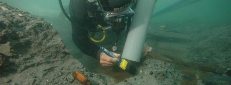 CMA student excavating the 'Axe Boat', Devon, England.