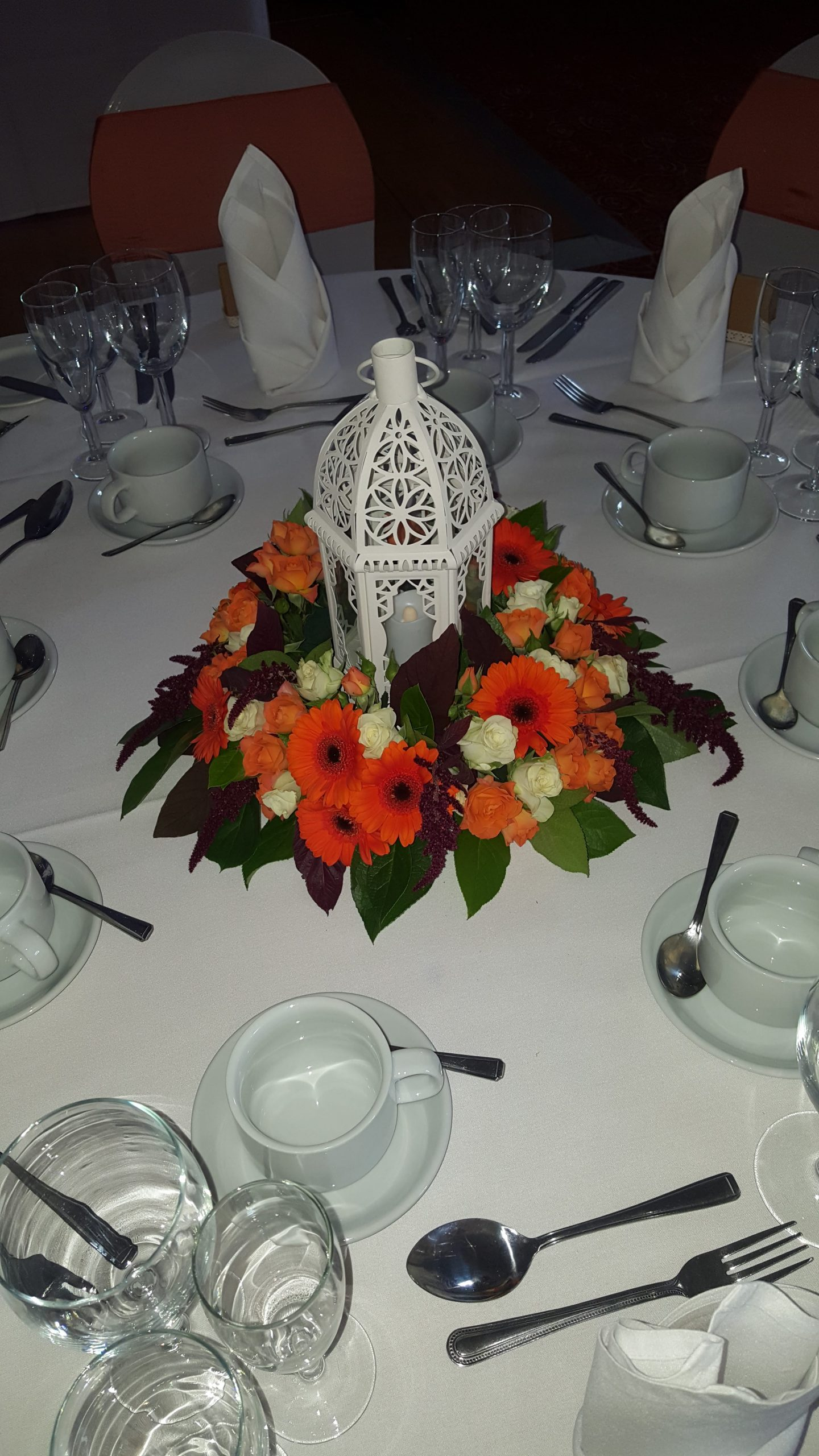 Lantern Table Centers with Orange Flowers